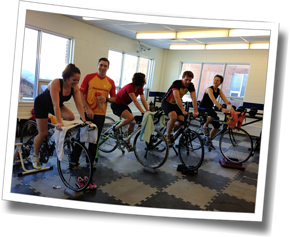 Athletes enjoy an indoor bike workout led by Coach Brad Walker at a DZ triathlon training day - Laurentian University, Sudbury, Ontario