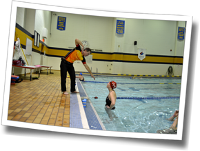 Coach Mike Coughlin demonstrates triathlon-specific swim stroke technique, poolside at DZ Big Training Day 3 - Sudbury, Ontario