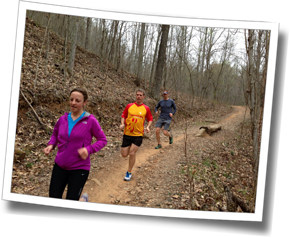 Athletes James and Michelle run trail Head Coach Mike Coughlin in the Bent Creek Experimental Forest, DZ Asheville Spring Triathlon Camp, Asheville, North Carolina, 2013
