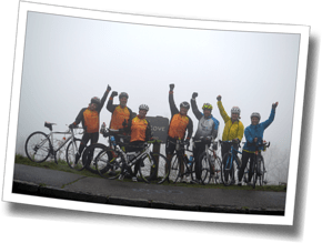 The Discomfort Zone Athletes conquer the Walnut Cove Overlook on the Blue Ridge Parkway, despite a seriously wet, foggy day - DZ Asheville Triathlon Camp 2014