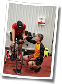 Head Triathlon Coach Mike Coughlin helps an athlete at Discomfort Zone Fall Triathlon Clinic 2016