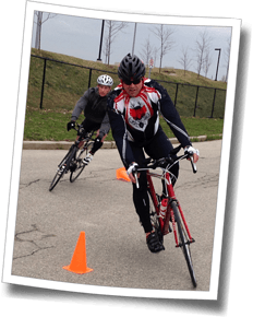 Athletes practice bike handling skills at Discomfort Zone Spring Triathlon Clinic 2014