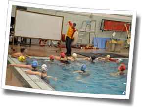 Head Coach Mike Coughlin demonstrates a drill at DZ Stroke Improvement & Triathlon Clinic, Winter 2014