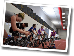 Group workouts indoors at the indoor track mean athletes can practice bike/run multibrick training at DZ Winter Triathlon Clinic.