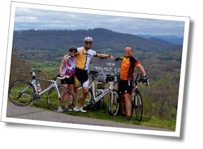 Group shot of triathletes James, Michelle, and Michael after repeats of Tunnel Hill, at the Walnut Cove Overlook, Blue Ridge Parkway, North Carolina