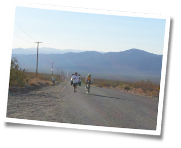 Khai hands off a bottle with Team Tufted Titmouse at the 2013 Furnace Creek 508