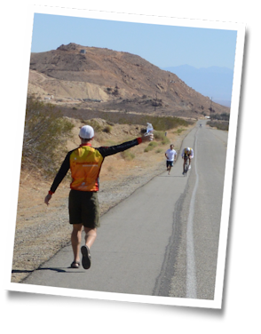 Mike hands off a bottle with Team Tufted Titmouse at the 2013 Furnace Creek 508